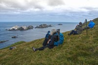 Enjoying the view at Muckle Flugga by Mick Durham